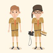 Boyscout with binoculars. Smart boy training to scout.