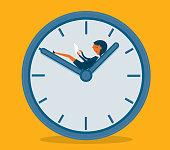 Businesswoman sitting on the clock