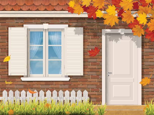 brick house facade in autumn season The brick house facade with dooryard in the autumn season. Maple tree branch with fallen leaves. Vector realistic illustration. front door stock illustrations