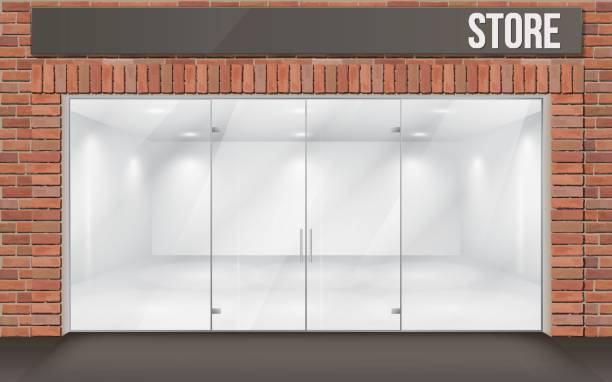 brick store front with big window Brick facade of the store with large transparent storefronts. The empty space inside is illuminated. facade stock illustrations