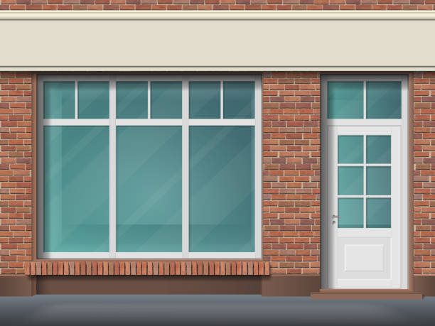 Brick store front with large transparent window Store front with large transparent window. Facade of red brick. Empty glass showcase of boutique. Entrance in the small  shop. facade stock illustrations