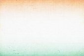 A horizontal vector illustration of tricoloured three bands in saffron, off white and green colors on a wall made by bricks. The orange and green at the top and bottom, blend into the off white central band. A peaceful patriotic theme faded wallpaper. Apt for use of national festivals of India, Niger and also of Ireland and Côte d'Ivoire (Ivory Coast). The off white band is the biggest and has ample copy space.