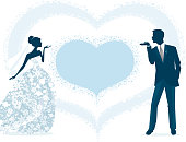 Bride and groom blowing kisses to each other. The blown hearts for a bigger heart for your message. Bride is wearing beautiful ball gown style wedding dress. This illustration is uses no gradients.
