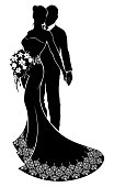 A bride and groom wedding couple in silhouette holding hands with the bride in a bridal dress gown with abstract pattern holding a floral bouquet of flowers