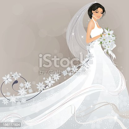 Pretty bride in long flowing wedding dress with flowers and lots of copy space.