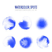 Bright Blue Watercolor Circle Splashes Set Isolated on White Background. Blue Ink Patches Set. Watercolor Circles or Spots Collection. Design Element for Greeting Cards and Labels, Abstract Background.