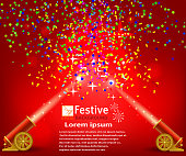 Bright festive red background with confetti and two firing canno