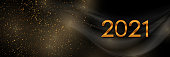 Bright golden and black abstract 2021 New Year background with sparkling dust and smooth waves. Vector banner design