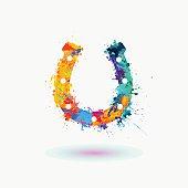 Bright horseshoe icon of watercolor splashes