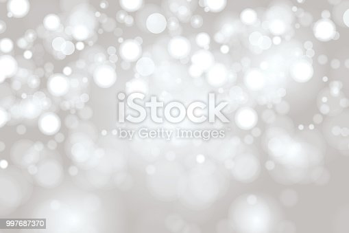 istock Bright Light grey high key bokeh dot background 997687370