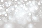 istock Bright Light grey high key bokeh dot background 997687370