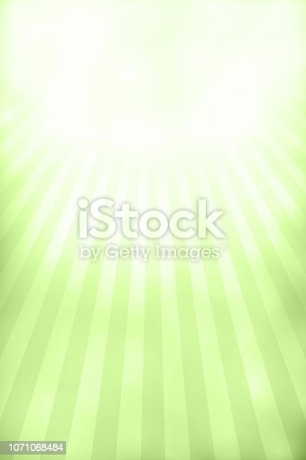 Lime green and white bright grunge Sunburst textured vector Xmas background- vertical . Rectangular grunge background. The center / centre of the sunburst is the top middle of the frame. The sunburst beams alternate in slightly light and darker shades of lime green with a tint of white at the origin. A peaceful spectrum of light. Vignetting. There is a white and  greenish cloudy patch  at the top near the origin of sunburst. copy space.