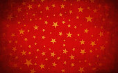Red Grungy Vector Starry Background. Golden Yellow stars of different sizes. Can be used as Xmas , New Year or birthday party background or gift wrapping sheet. Happy festive background. wallpaper with golden pentagram stars. Dark corners and sides. Centre highlighted and bright. Stars are in different sizes, small, medium. Randomly placed.