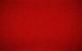 Bright red coloured half tone vector background illustration. No text. No People. Copy space. Vignetting. A pattern of small tiny squares all over the frame. Festive festival look party wallpaper or background. Can be used as a gift wrapping sheet.