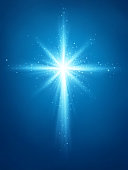 Easter background with light and cross of rays and light with shiny stars. EPS contains transparency.