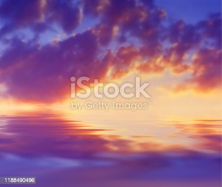 Sunset cloudy landscape over the water. Vector illustration. Bright sunset clouds over water surface