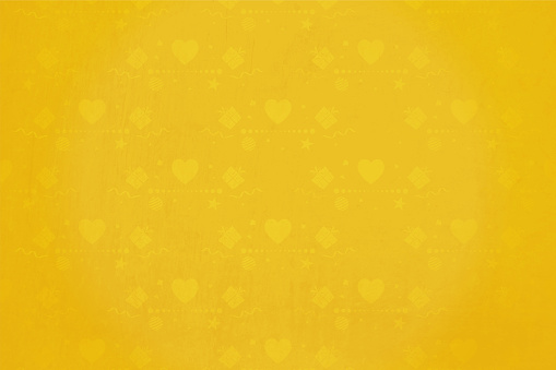 Bright yellow colored grunge background with Christmas ornaments like small stars, gift boxes, hearts, swirls  and baubles as watermark