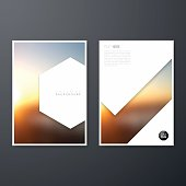 Set of two vertical brochure templates with an abstract background, blurred sunset.