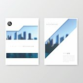 Set of two vertical brochure templates with an view of skyscrapers. Blurred city background.
