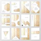 Set of twelve vertical brochure templates with an textured wooden background.