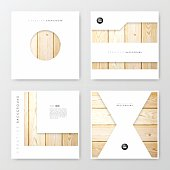 Set of four brochure templates with an textured wooden background.