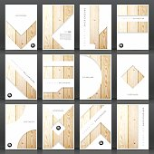 Set of twelve vertical brochure templates with an textured wooden background.