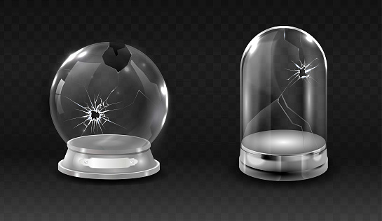 Broken glass globe, cracked empty glass bell jar.