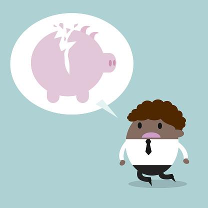 broken piggy bank. Depressed business man