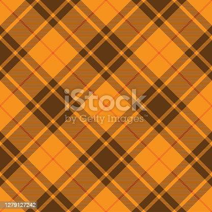 istock Brown And Orange Argyle Scottish Tartan Plaid Textile Pattern 1279127242