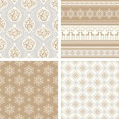 A collection of brown and silver grey seamless Christmas patterns. With retro swirl design elements of Christmas ornaments, snowflake, reindeer and more.
