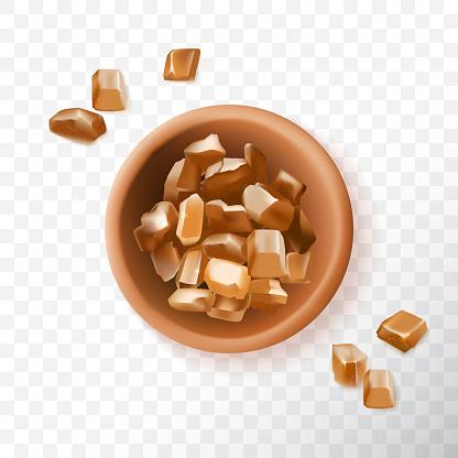 Brown sugar crystals in ceramic bowl, raw cane sugar top view