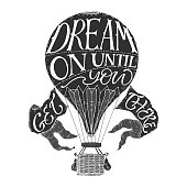 Hand drawn typography poster. Brush lettering phrase in a vintage hot air balloon form. Inspiration quote saying Dream on until you get there. Great for posters, greeting cards.
