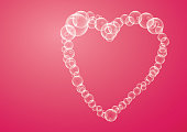 heart made of bubbles on a pink background