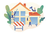 Build and Home Repair concept. Tiny men builders and repairers working with professional tools. Modern building process. Modern flat cartoon style. Vector illustration
