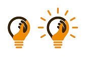 istock Bulb icons with human hand and light beams 1164291572