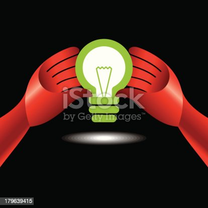 bulb idea with human hand on black background