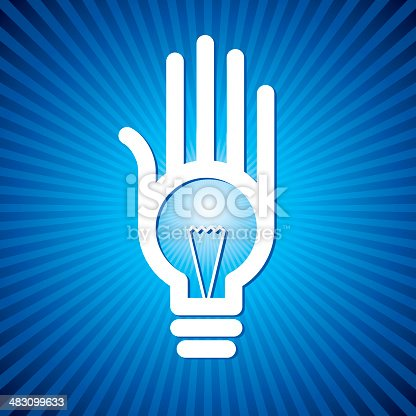 bulb idea in human hand on blue rays background