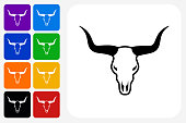 Bull Head Icon Square Button Set. The icon is in black on a white square with rounded corners. The are eight alternative button options on the left in purple, blue, navy, green, orange, yellow, black and red colors. The icon is in white against these vibrant backgrounds. The illustration is flat and will work well both online and in print.