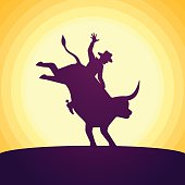 Bull rider rodeo sunset silhouette concept. EPS 10 file. Transparency effects used on highlight elements.