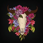 Bull skull decorated with flowers tattoo or t-shirt print concept