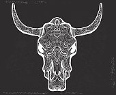 Vector illustration of a very ornate doodle bull skull on chalkboard texture. Lot's of detail.