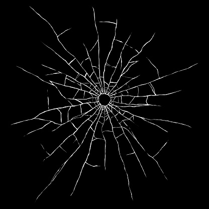 Bullet hole in glass isolated black background. Cracked mirror texture.