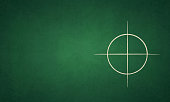 Bull's eye - A chalk drawing of a circle drawn in all four quadrants on a green board