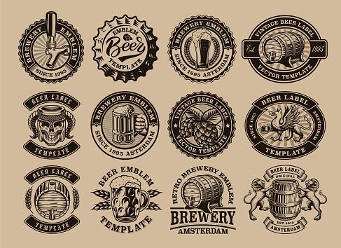 A bundle of black and white vintage beer emblems
