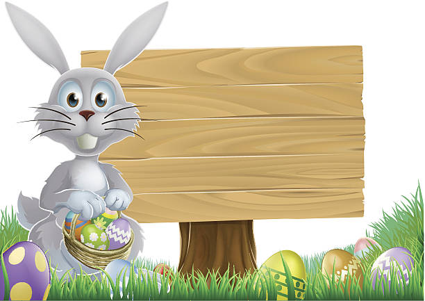 Bunny and Easter message sign Easter bunny rabbit with a wooden sign holding chocolate Easter eggs basket animal stage stock illustrations