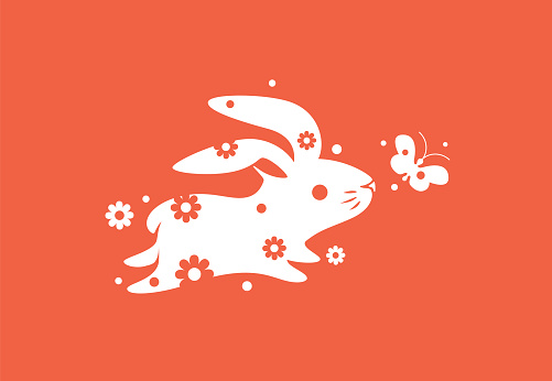 bunny running with flower and butterfly symbol