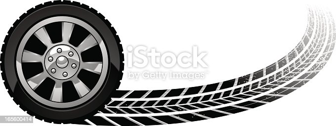 tire leaving behind a curved skid mark