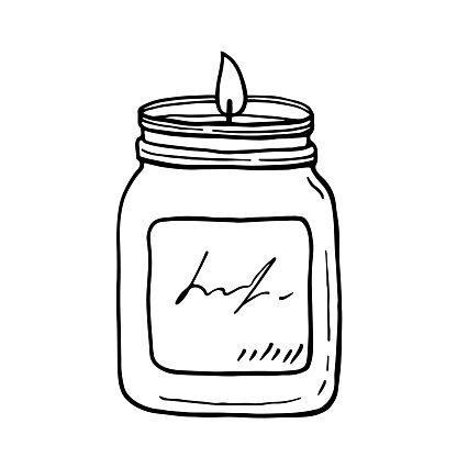 Burning aroma candle in a jar isolated on white background