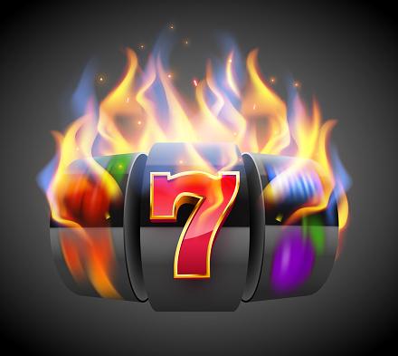 Burning slot machine wins wins the jackpot. Fire casino concept. Hot 777