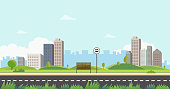 Bus stop on main street city with grass foregraound.Public park with bench and bus stop with buidings and sky background.Beautiful nature scene with town and hill.Clean spring amazing scenery vector.